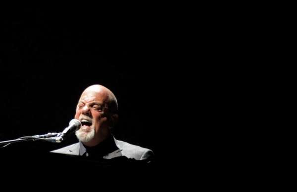 Billy Joel performs live for an audience at