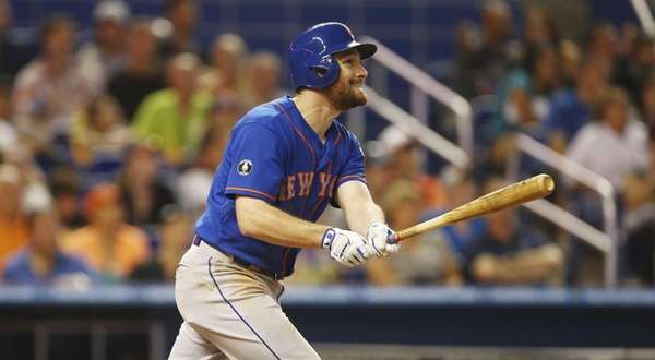 The Mets' Daniel Murphy smiles as he hits