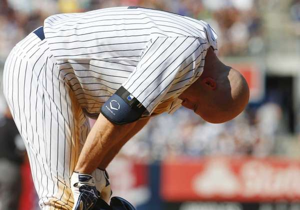 Brett Gardner of the Yankees reacts after making