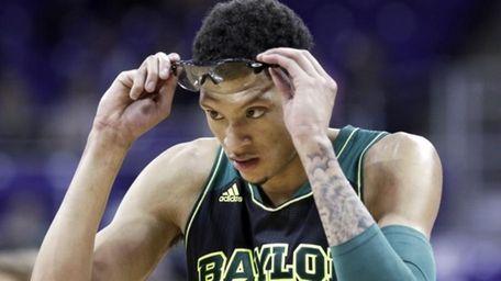 Baylor center Isaiah Austin (21) adjusts his glasses