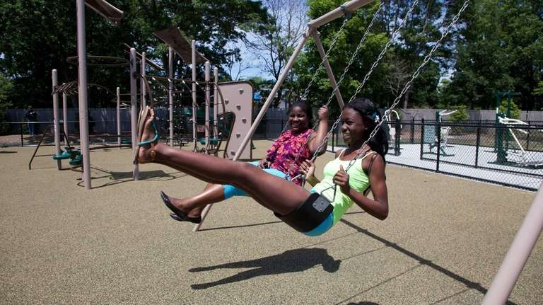 Jimmeisha Rowe, 15, right, and Moneike Brown, 14,