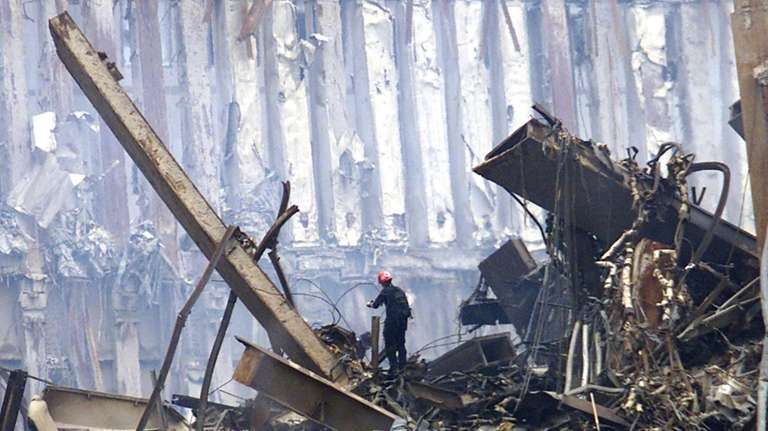 A rescue worker searches through a pile of
