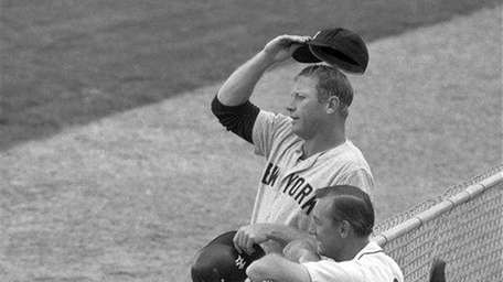 New York Yankees Mickey Mantle, left, and Detroit