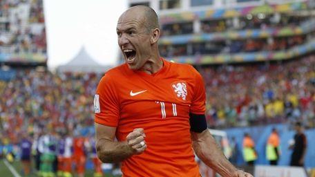 Netherlands' Arjen Robben celebrates after his team scored