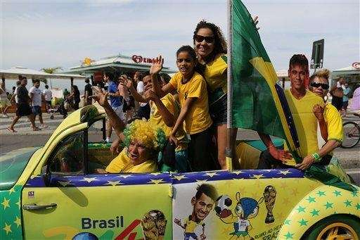 Soccer fans in Brazil's national team colors wave