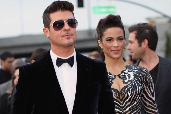 Robin Thicke and actress Paula Patton attend the