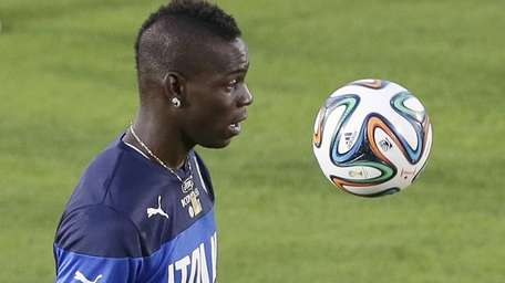 Italy's Mario Balotelli controls the ball during a