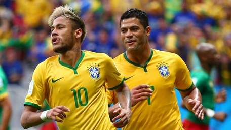 Brazil's Neymar, left, celebrates after scoring his team's