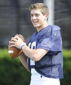 Quarterback Ben Kocis of Huntington takes part in