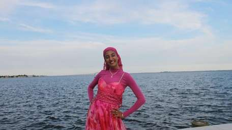 Zaynam Mossolem, 17, shows off her head-to-toe pink