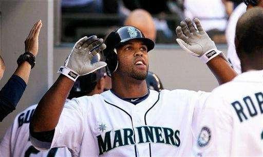 Former Mariners outfielder Carlos Peguero's wife was sentenced