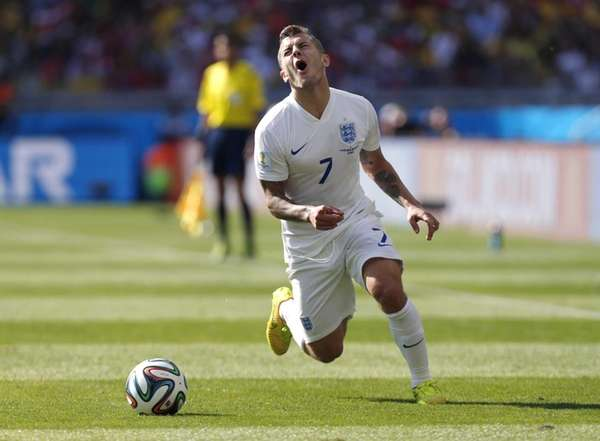 England's Jack Wilshere reacts after being penalised during