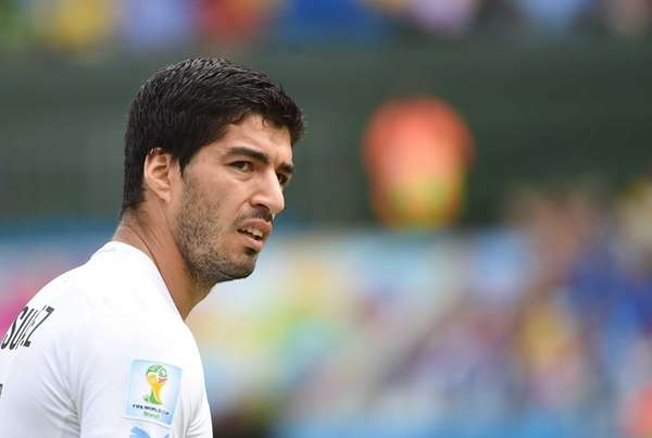 Uruguay's forward Luis Suarez attends the Group D