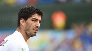 Uruguay's forward Luis Suarez attends the Group D