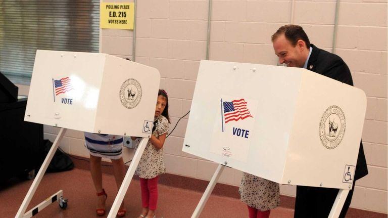 State Sen. Lee Zeldin casts his vote at