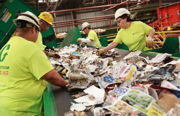 Workers at the Town of Brookhaven recycling center