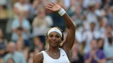 Serena Williams celebrates after beating Anna Tatishvili during