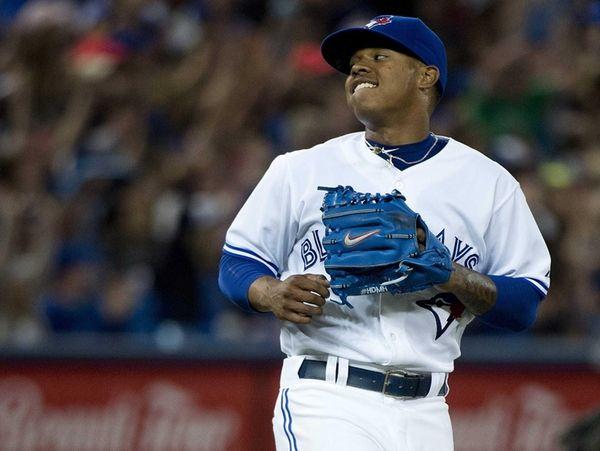 Toronto Blue Jays starting pitcher Marcus Stroman reacts