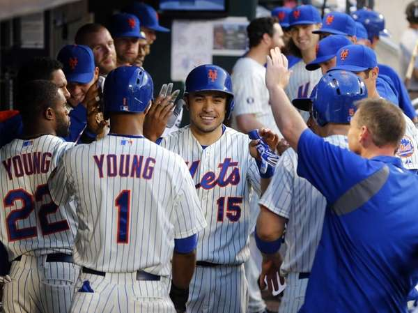 Travis d'Arnaud of the Mets celebrates his third-inning,