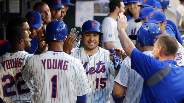 Travis d'Arnaud of the Mets celebrates his third-inning,