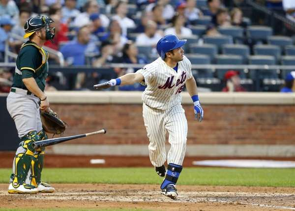 Travis d'Arnaud of the Mets follows through on