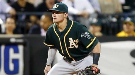 Josh Donaldson of the Oakland Athletics defends at