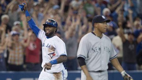 Toronto Blue Jays' Jose Reyes, left, celebrates before