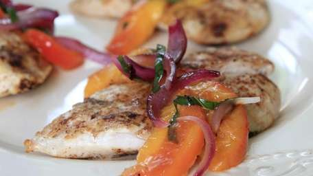 Grilled chicken breasts get smoky, spicy flavor from