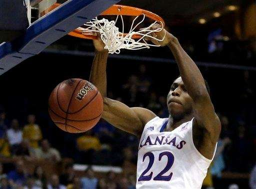 Kansas' Andrew Wiggins dunk during the second half
