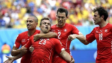 Switzerland's Xherdan Shaqiri (23) celebrates with teammate Goekhan