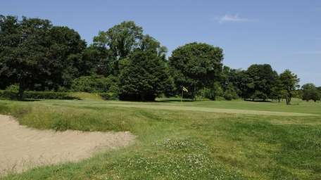 A view of a bunker and green at