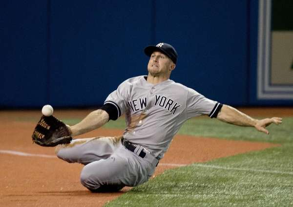 Yankees leftfielder Brett Gardner makes a sliding catch