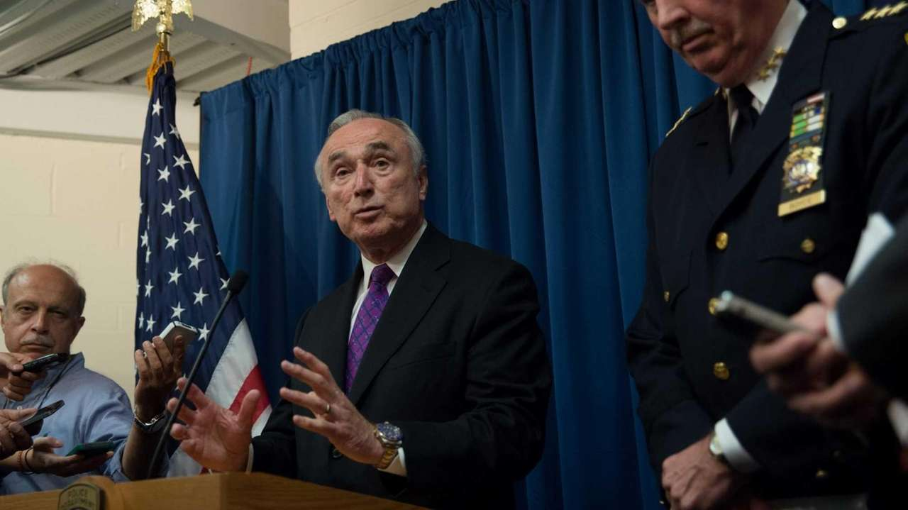 New York Police Commissioner Bill Bratton speaks with