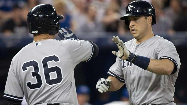 The Yankees' Mark Teixeira, right, celebrates his two-run