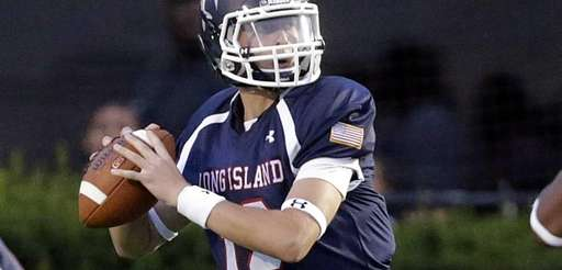 Long Island quarterback Ben Kocis (12) steps into