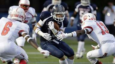 Long Island's Andrew Ris (13) looks for running