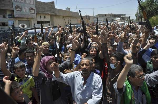 Mourners chant slogans against the Islamic State of