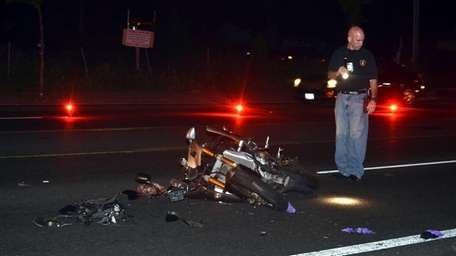 Suffolk County police investigate a motorcycle accident on