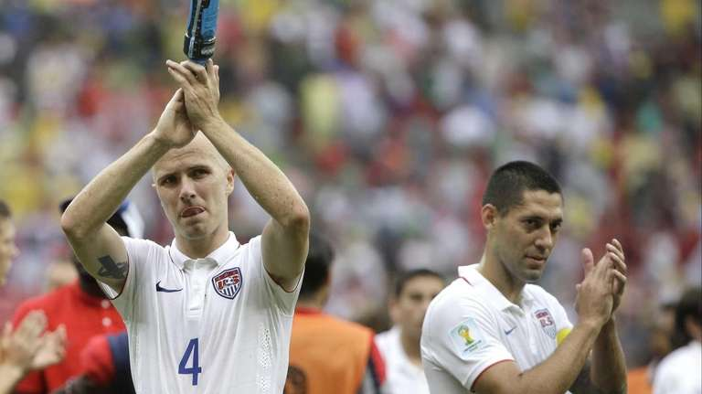 The United States' Michael Bradley, left, and Clint