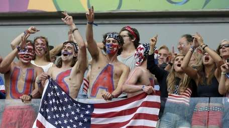 USA fans celebrate after team USA qualifyied for