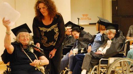 Valedictorian Berthe Gersten, 93, of Commack, congratulates fellow
