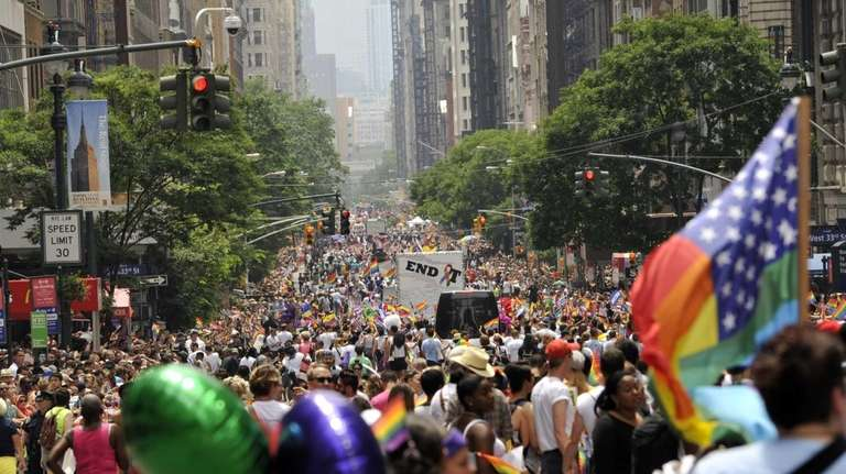 Marchers walk down 5th Avenue during the 2013