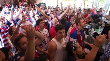 Fans react as they watch the USA playing