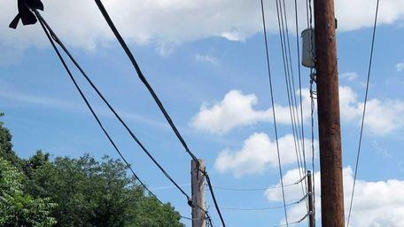 Double poles line Maple Street in Manhasset on