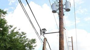 Double poles align Maple Street in Manhasset on