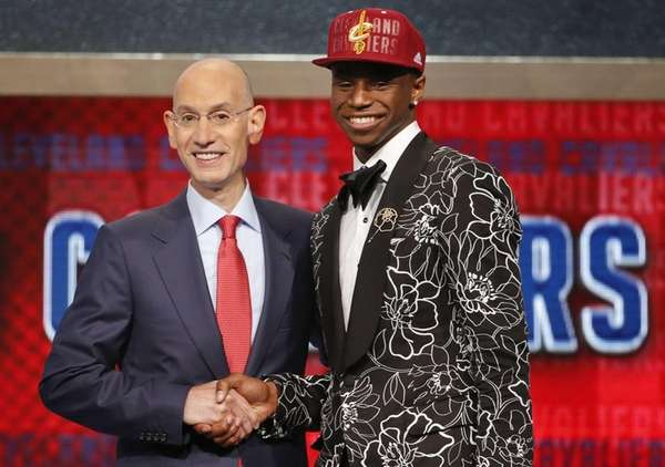 NBA Commissioner Adam Silver, left, congratulates Andrew Wiggins
