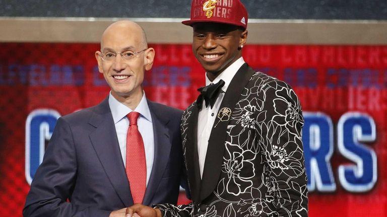 NBA Commissioner Adam Silver, left, congratulates Andrew Wiggins