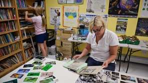 Volunteer archivist Pamela Hansen organizes old camp photos