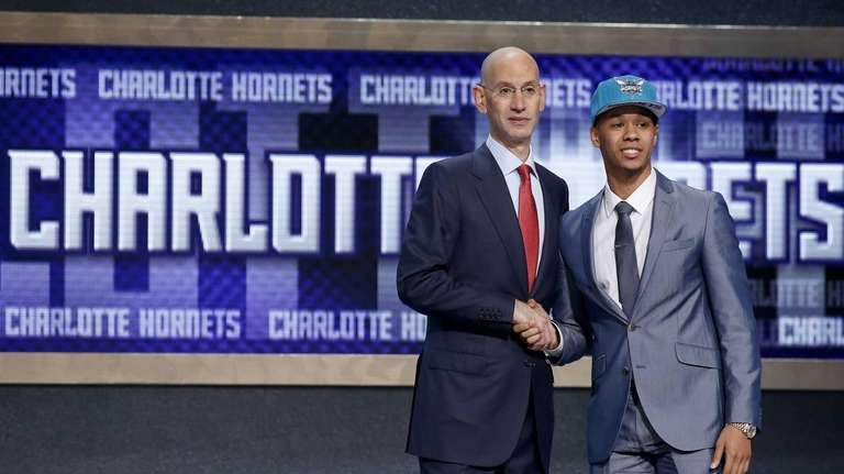 Connecticut's Shabazz Napier, right, poses for photos with
