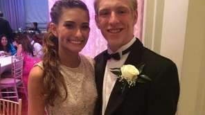 Senior Caity Fischer, 17, poses with date, James